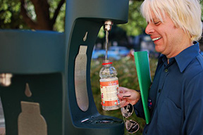 History lecturer Van Herd fills up his water bottle at a water bottle filler station