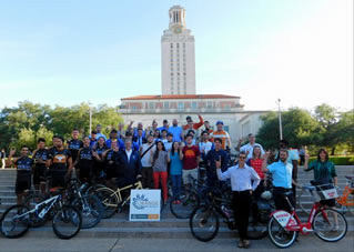 Orange Bike Project in front of UT tower