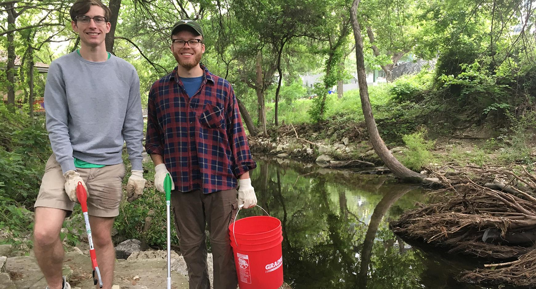 Jack Rouse and James Collins cleaning Waller Creek